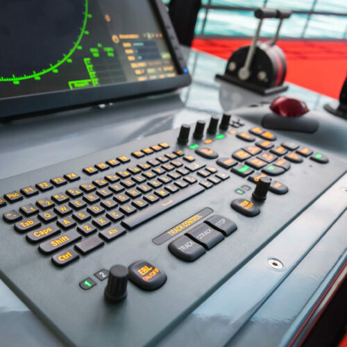 Modern ship control panel with radar screen, accelerator, trackball and keyboard